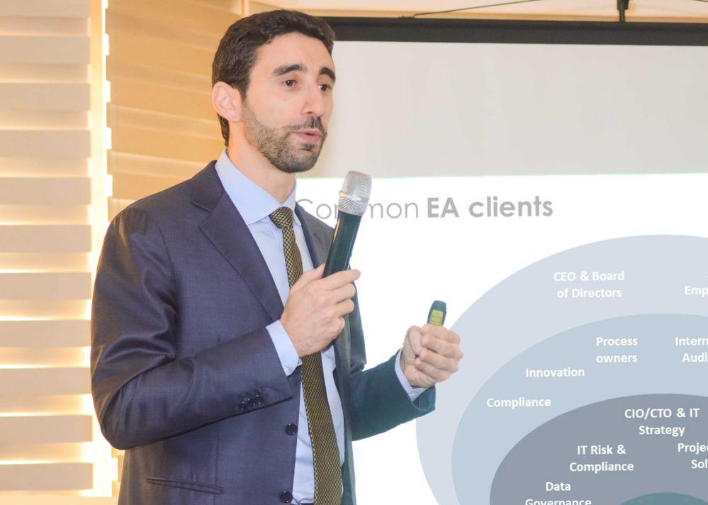 Luca de Risi presenting a slide on common EA clients